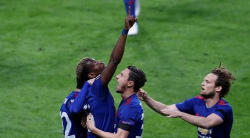 Manchester United's Paul Pogba celebrates scoring their first goal with Matteo Darmian and team mates